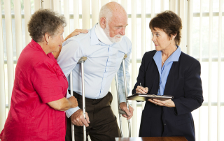 Personal injury attorney interviewing a man on crutches